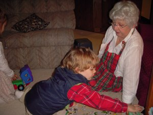 Caleb working on a puzzle with Grammy