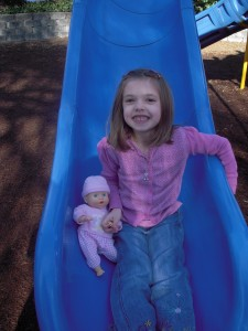 Rylee and her new baby Alexis on the slide