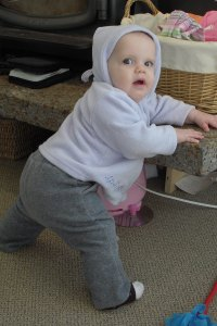 Audrey pulled herself up on the fireplace this morning-first time, all by herself!  She is 9 months this week